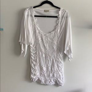 NWOT White shirt with appliqué.